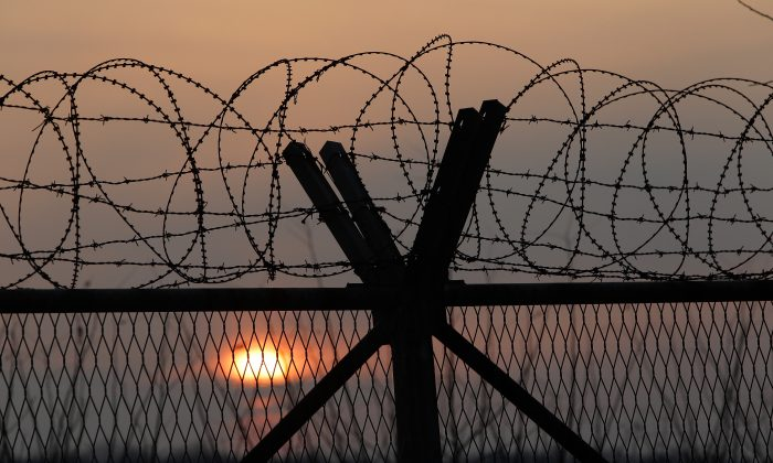A barbed wire fence at a military check point near the demilitarized zone (DMZ) separates South and North Korea, in Paju, South Korea, on Jan. 6, 2016. (Chung Sung-jun/Getty Images)