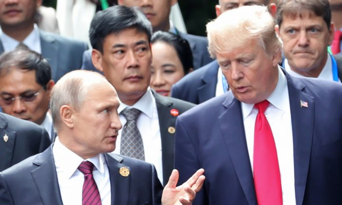 President Donald Trump and Russia's President Vladimir Putin talk as they make their way to take the 'family photo' during the Asia-Pacific Economic Cooperation (APEC) leaders' summit in the Danang, Vietnam, on Nov. 11, 2017. (Mikhail Klimentyev/AFP/Getty Images)
