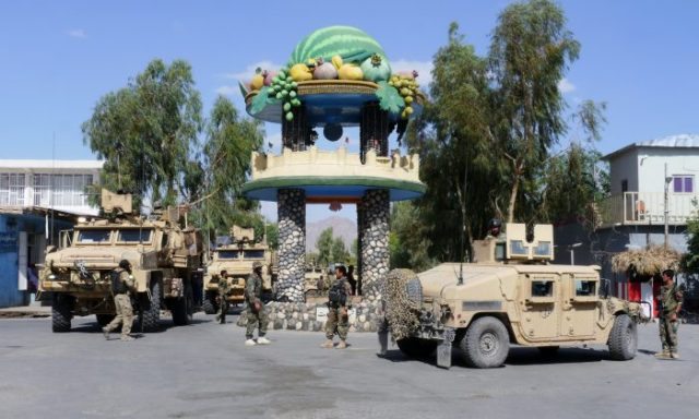 Afghan security forces patrol the town of Farah, after having driven the Taliban out, on May 19, 2018. (HAMEED KHAN/AFP/Getty Images)