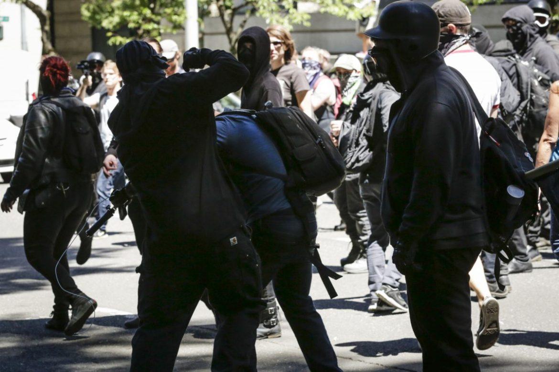 Antifa members beat up Andy Ngo