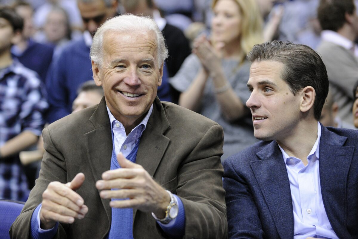 Former Vice President Joe Biden (L) with his son Hunter (R) at the Duke Georgetown NCAA college basketball game in Washington on Jan. 30, 2010. (Nick Wass/AP Photo)