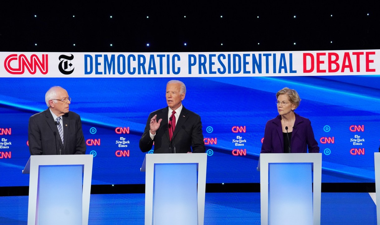 Democratic presidential candidate former Vice President Biden speaks as Senators Warren and Sanders listen during the fourth U.S. Democratic presidential candidates 2020 election debate at Otterbein University in Westerville, Ohio U.S.