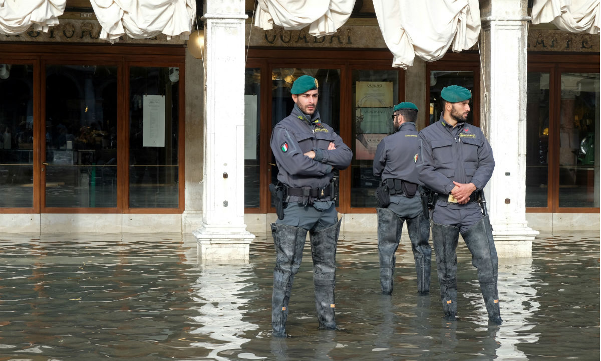 Police patrol after flood in Venice Italy