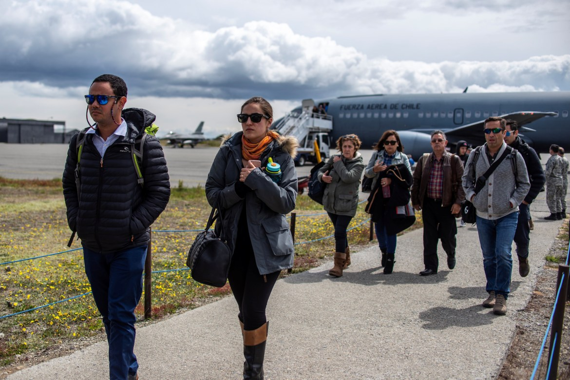 Relatives of passengers on the Hercules C-130 aircraft of Chile's Air Force that crashed arrive at an Air Force base in Punta Arenas city