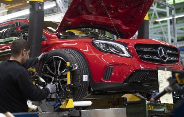 employee assembles a car