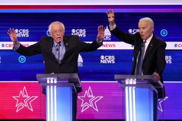 Sen. Bernie Sanders speaks as former Vice President Joe Biden reacts