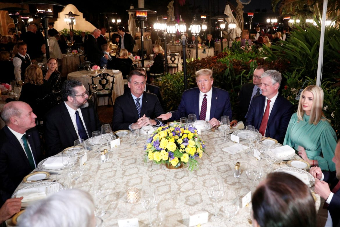 President Donald Trump participates in a working dinner with Brazilian President Jair Bolsonaro at the Mar-a-Lago resort in Palm Beach, Florida