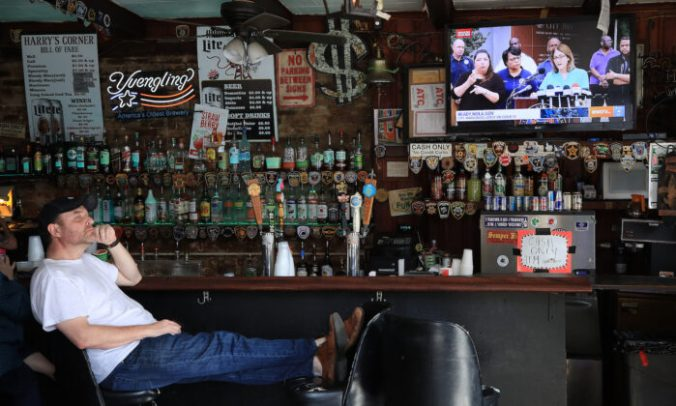 A man watches a press briefing from Mayor LaToya Cantrell in a bar in the French Quarter on March 15, 2020 in New Orleans, Louisiana, on March 15, 2020. (Chris Graythen/Getty Images)