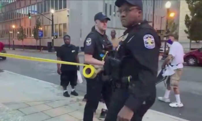 Man Who Participated in Protests Charged With Murder of Photographer