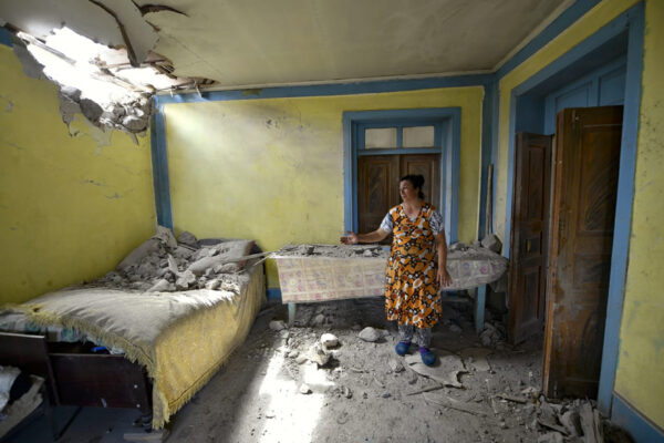 A local woman shows damage in her house-1