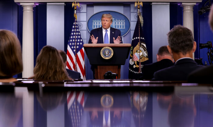 President Donald Trump talks to journalists during a news conference about his administration's response to the COVID-19 pandemic in the Brady Press Briefing Room at the White House in Washington on July 22, 2020. (Chip Somodevilla/Getty Images)