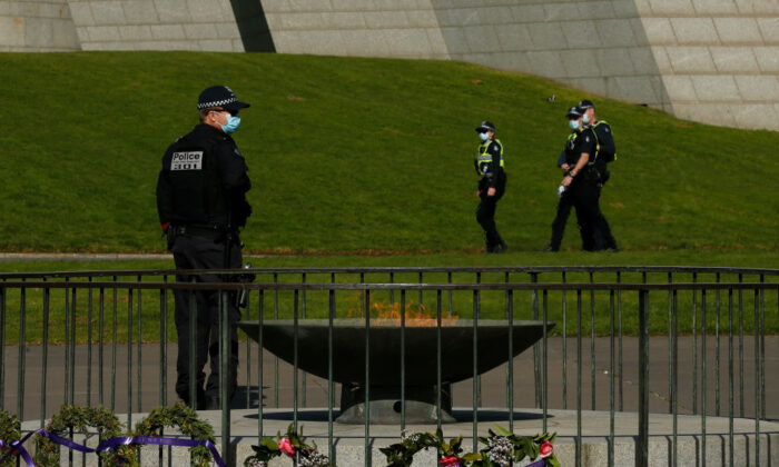 Members of Victoria Police patrol around the Shrine of Remembrance enforcing COVID restrictions on July 31, 2020, in Melbourne. (Darrian Traynor/Getty Images)