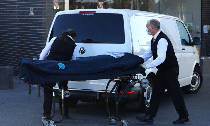 A body is removed from the Epping Gardens Aged Care Home, Melbourne, Australia on July 29, 2020. (Robert Cianflone/Getty Images)