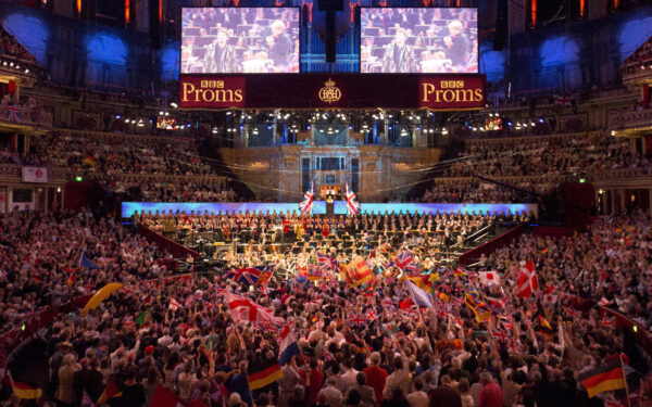 Revellers waving British flags as they enjoy 'The Last Night of the Proms' celebration in Hyde Park, in London on Sept. 14, 2018