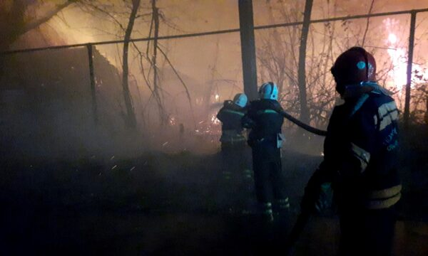 Firefighters work at a settlement