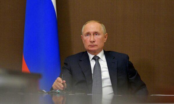 Russian President Vladimir Putin chairs a meeting