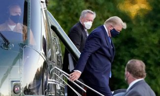 President Donald Trump arrives at Walter                           Reed National Military Medical Center, in                           Bethesda, Md., on Marine One helicopter on                           Oct. 2, 2020. (Jacquelyn Martin/AP Photo)
