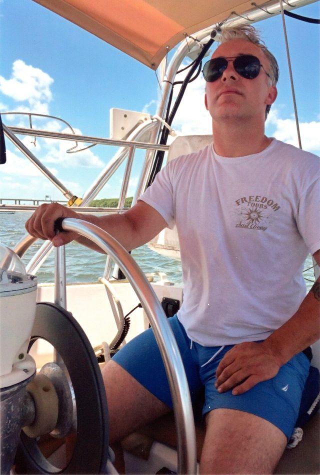 Matthew Heath navigates a boat near the Florida Keys