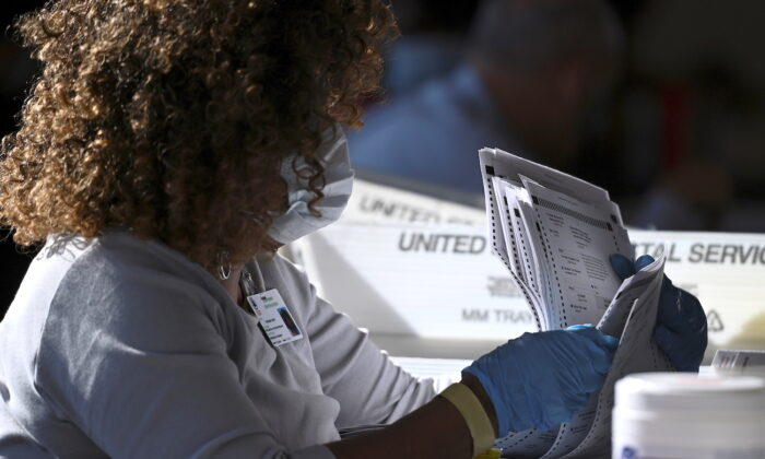 An employee of the Fulton County Board of Registration and Elections processes ballots in Atlanta, Ga., on Nov. 4, 2020. (Brandon Bell/Reuters)