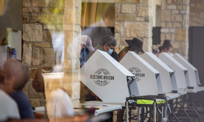 People cast their ballots at a polling location in Austin, Texas, on Oct. 13, 2020. (Sergio Flores/Getty Images)