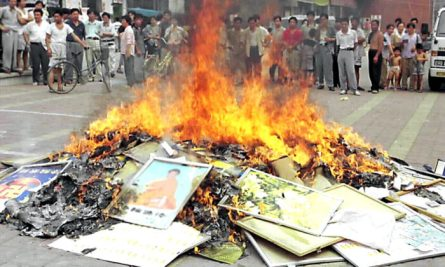 Falun Gong books are set on fire in Shouguang City, China's eastern Shandong Province, on Aug. 4, 1999. Chinese authorities in cities across China burned millions of Falun Gong books and materials after the communist regime launched a campaign to persecute the spiritual practice in July 1999. (STR/XINHUA/AFP via Getty Images)