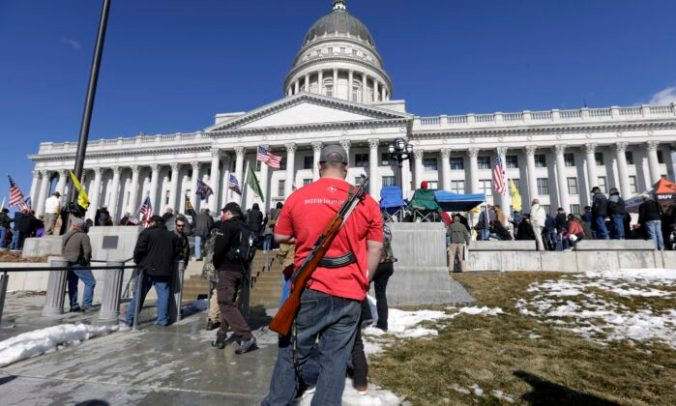A man carries his weapon during a pro-Second Amendment rally at the Utah State Capitol in Salt Lake City on Feb. 8, 2020. (Rick Bowmer/AP Photo)