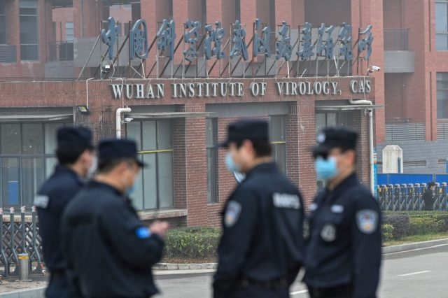 guard outside the Wuhan Institute of Virology