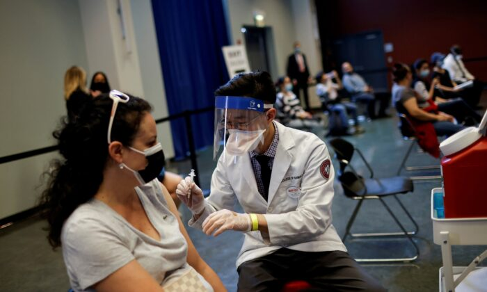 A woman receives a dose of the Johnson & Johnson COVID-19 vaccine at vaccination center in Chinatown, in Chicago U.S., April 6, 2021. (Reuters/Carlos Barria)