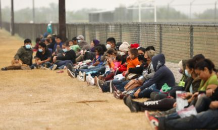 A group of illegal immigrants wait for Border Patrol after crossing the U.S.-Mexico border in La Joya, Texas, on April 10, 2021. (Charlotte Cuthbertson/The Epoch Times)