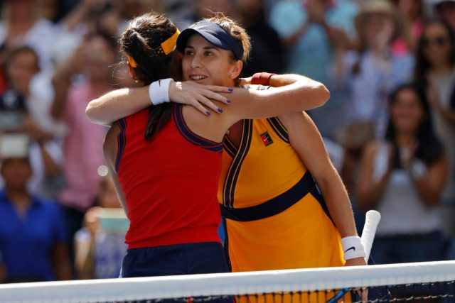Emma Raducanu of Great Britain (L) hugs Belinda Bencic of Switzerland (R)