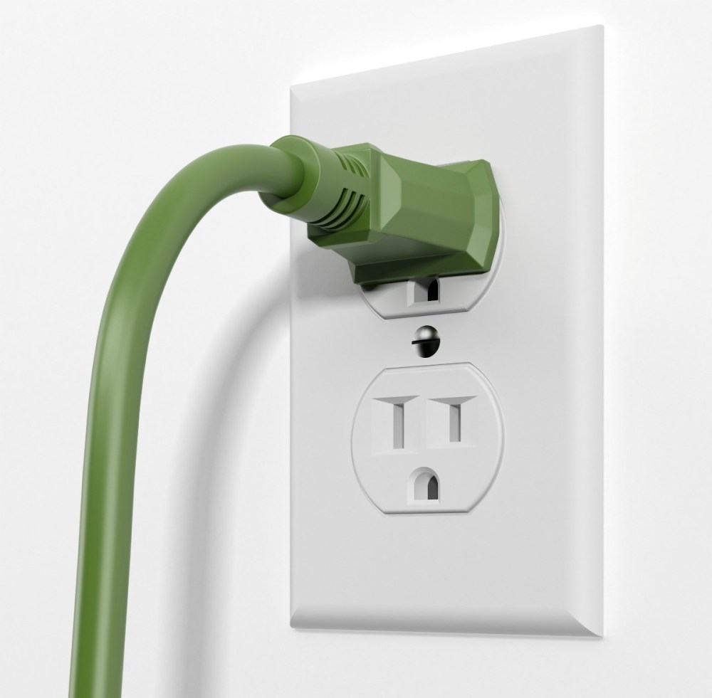 medium resolution of electrical outlet with a green cord plugged in