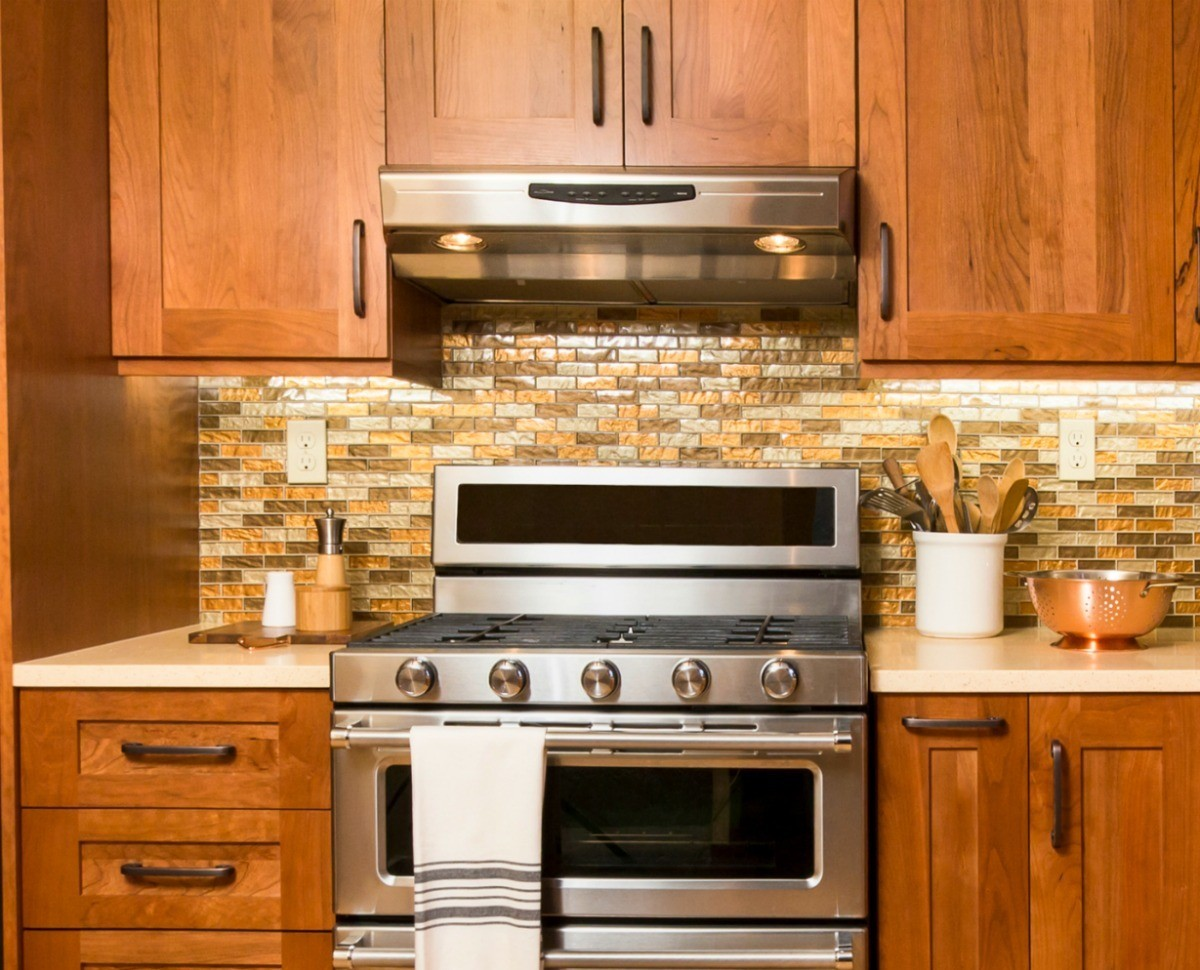 protecting cabinets above a stove