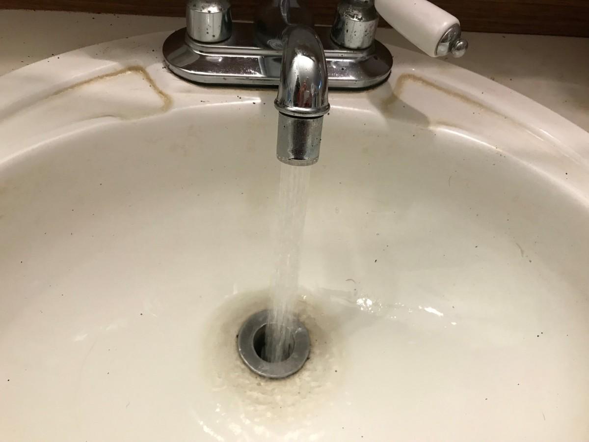 clearing a clogged bathroom sink