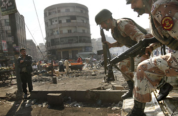Pakistani soldiers are deployed in a city market in Karachi, Pakistan. David Guttenfelder / AP