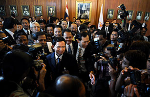 Thailand's newly elected Prime Minister Somchai Wongsawat, center, leaves the Parliament House in Bangkok on Sept. 17