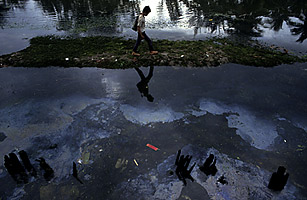 Pollution in a Vietnamese river. Robert Judges / Alamy