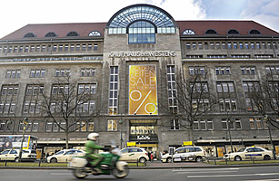 A police officer on a motorbike drives past the main entrance to Berlins iconic Kaufhaus des Westens department store