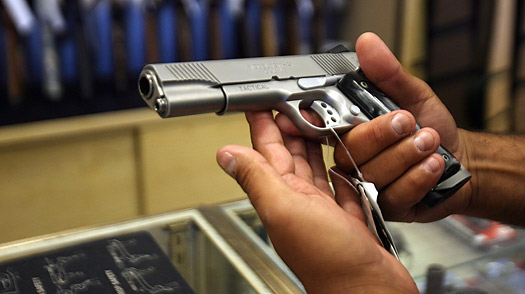 A customer samples a handgun at a shop in Glendale, Calif.