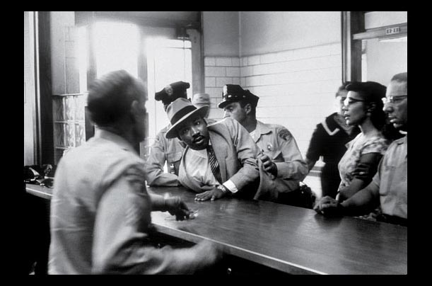 Dr. King is arrested after a protest in Montgomery, Ala. in 1958. Breaking unjust laws and accepting arrest was an integral part of the civil rights movements non-violent protest strategy (CHARLES MOORE / BLACK STAR)
