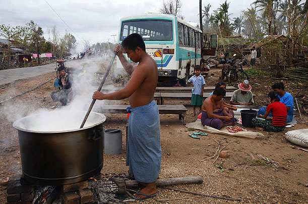 Cyclone affected people cook barley rice