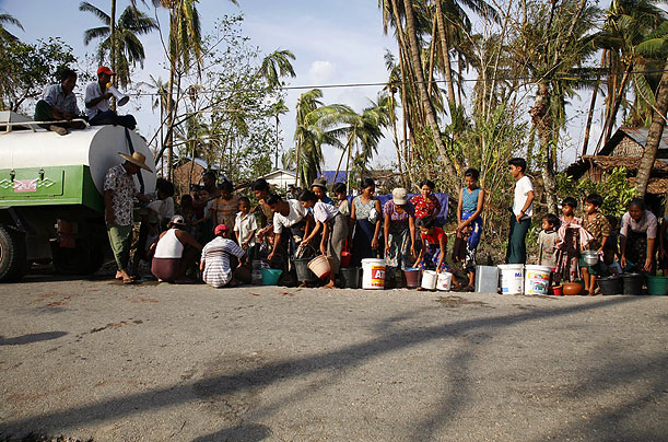People queue to get clean water
