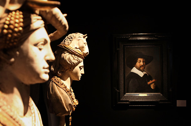 A pair of French carved wooden busts from the 18th century stand next to Frans Hals' portrait at Christie's auction house