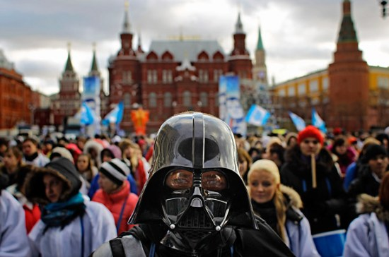 A member of the pro-Kremlin youth movement Stal (Steel) wears a Darth Vader mask at a rally in downtown Moscow, Dec. 6, 2011.