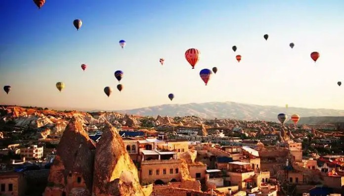 Sky full of hot air balloons in Cappadocia, one of best places to visit in Turkey