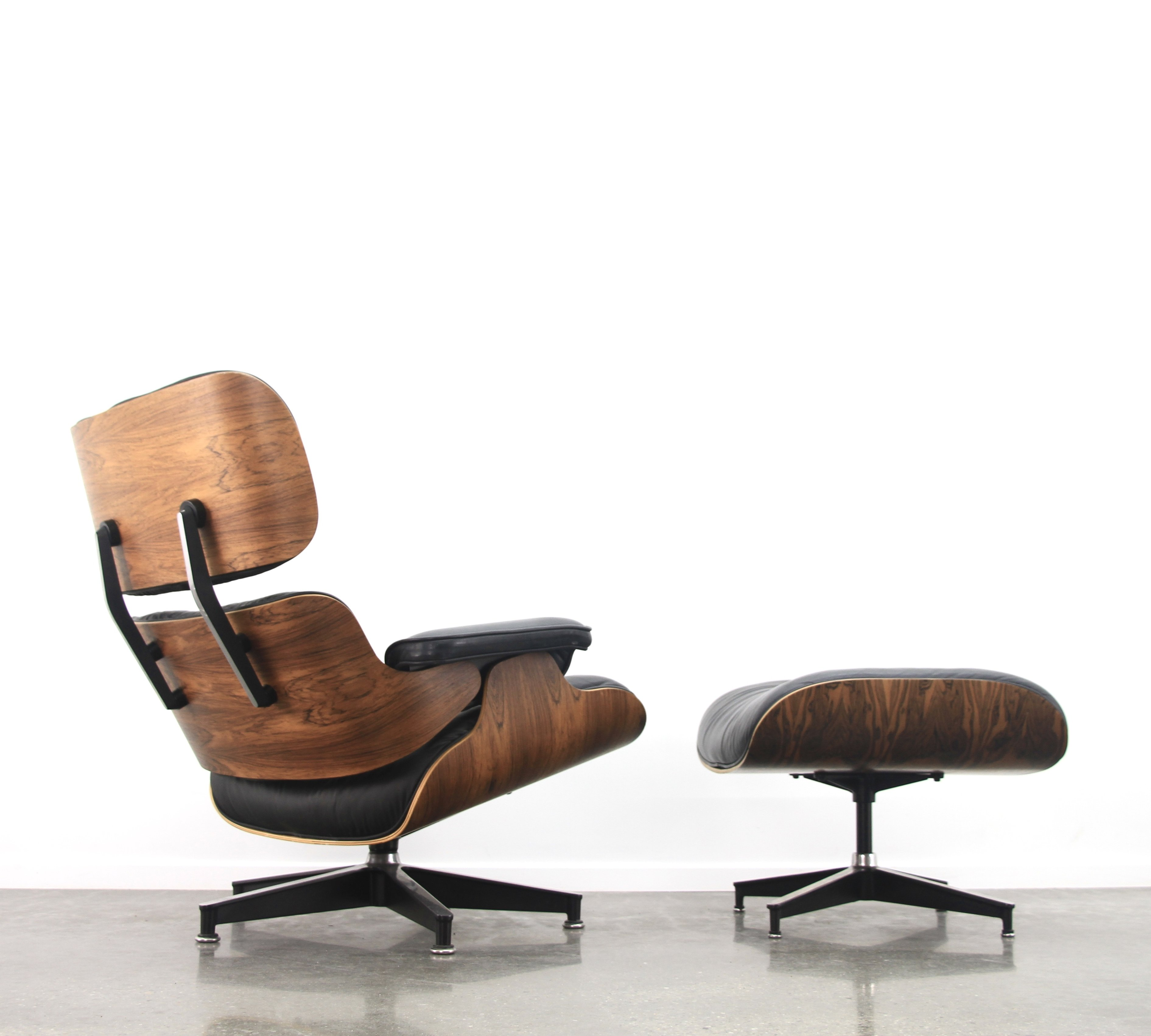 eames style lounge chair and ottoman rosewood black leather office elbow pads 43 in