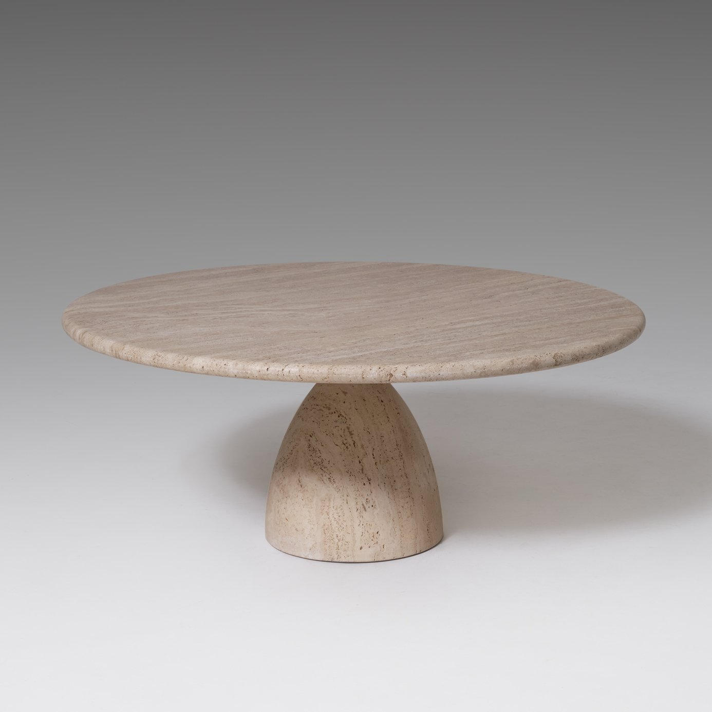 round travertine coffee table by peter