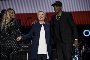 Hillary Clinton appears at a musical campaign rally headlined by singers Beyonc, left, and Jay Z, on Friday in Cleveland. (Melina Mara/The Washington Post)