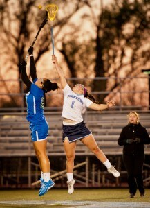 Laura Crawford skies for a draw during a 2016 game. (Photo courtesy of Donna Owens Photography)