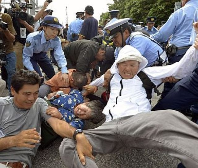 Police Officers Try To Remove Demonstrators Staging A Sit In Protest Against The Planned Deployment Of V 22 Ospreay Aircraft At Marine Corps Air Station