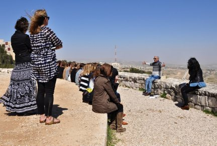 Daniel Seideman, the founder of the nonprofit Terrestrial Jerusalem, explains the borders of Jerusalem to the Telos trip participants in March 2015. (Photo by Christine Anderson)